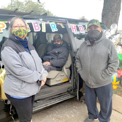 Seated in the van Friday afternoon, 101-year-old birthday boy Benny Benitez awaited his parade on 34th Street, featuring friends, family and Snyder Fire Department personnel. With Benitez are his daughter-in law Cris Benitez and son Ygnacio Benitez.