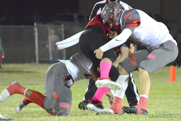 Devin Hildebrand (left) and Stetson Digby team up to take down a Roby ballcarrier