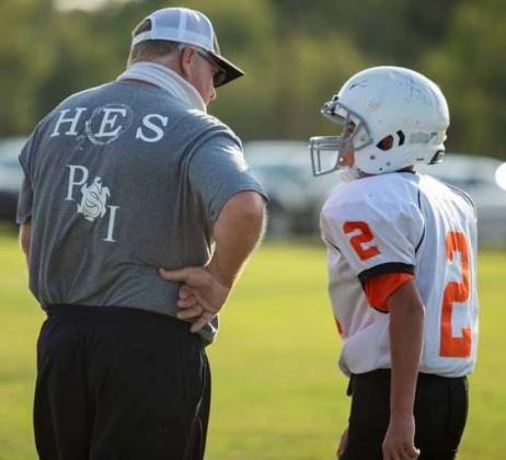 Ira head football coach Toby Goodwin (left) had a chat with Ira eight grader Jeren Pena. Pena plays running back for the Ira Junior High School football team.