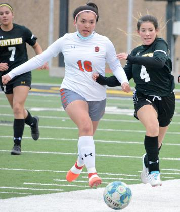 Snyder's Chelsea Luna (right) battled with a Caprock defender for possesion of the ball during the Lady Tigers' 3-0 loss to Caprock at Tiger Stadium on Friday.