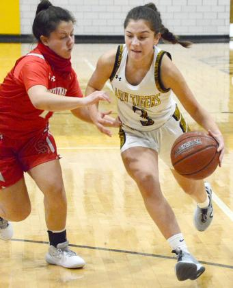 Snyder junior Taryn Nobles (right) dribbled past a Sweetwater defender during the Lady Tigers' 55-44 win over Sweetwater at Tiger Gym on Friday.