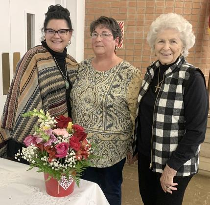 The Altrurian Daughters met February 10 at Martha Ann Woman's Club for a program by Sweet P's Floral Shop owner Shann Pierce. Pierce arranged a floral centerpiece and described the names and symbolism of each flower. Pictured (l-r) are hostess Joy Carthel, Pierce and hostess Francine Noah.