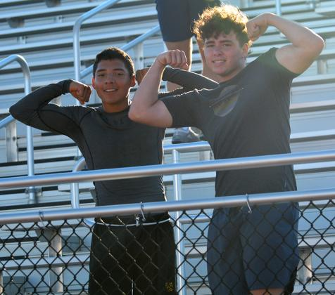 Snyder High School junior Jorge Martinez (left) and senior Talon Lee flexed during summer workouts at Tiger Stadium Thursday. The Snyder football team will begin pre-season practices Monday morning.