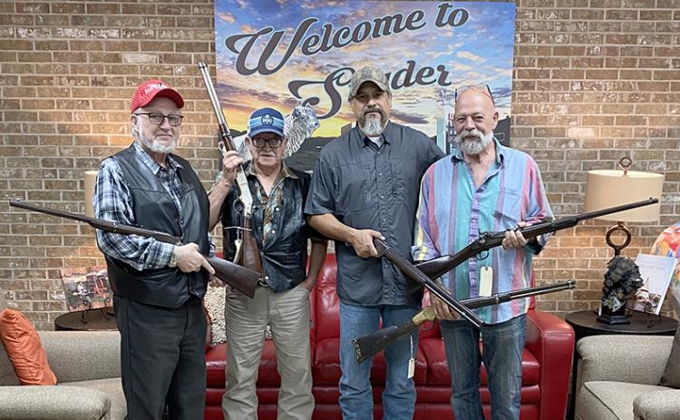 Wendell Grangaard, Ernie Fellows, Dave Molina and Nicholas Tooth showed rifles recovered from Custer's Last Stand.